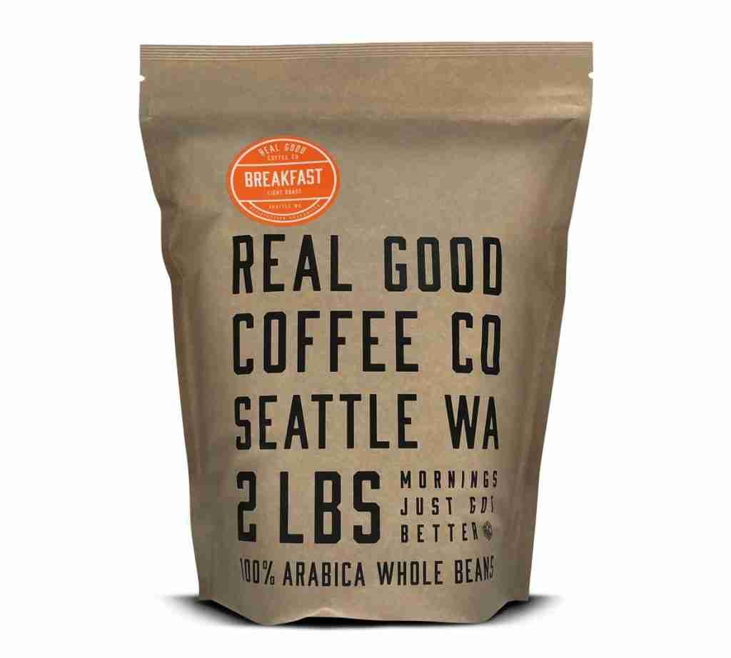 A new bag of 100% Arabica whole bean lightly roasted coffee by real good coffee co.