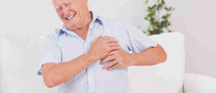Old man clutching his chest in pain