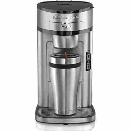 Hamilton Beach Single Serve Coffee Maker in Chrome in the middle of making a coffee into a chrome cup