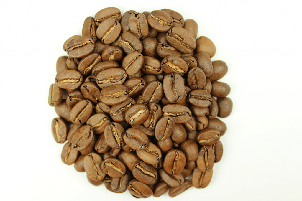 A pile of lightly roasted coffee beans.