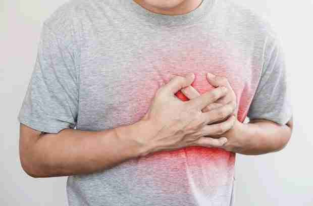 Man clutching chest from heart attack from too much bulletproof coffee