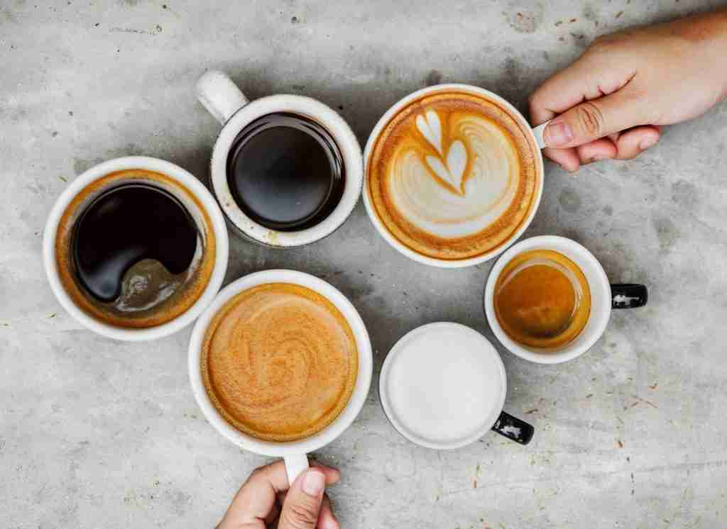 Americano, Latte, Black Coffee, Flat White, espresso on a table next to each other.