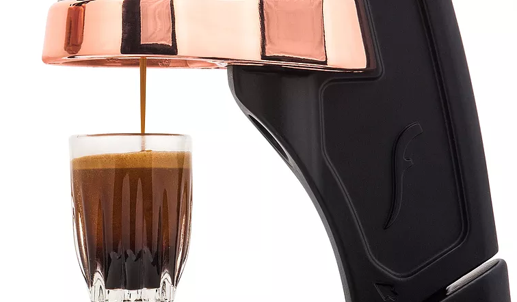 Flair espresso maker pouring out a shot of coffee.